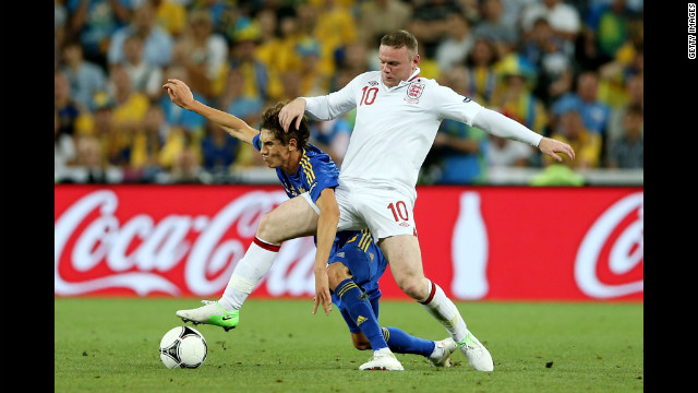 Wayne Rooney of England clashes with Denys Garmash of Ukraine during the match between England and Ukraine.