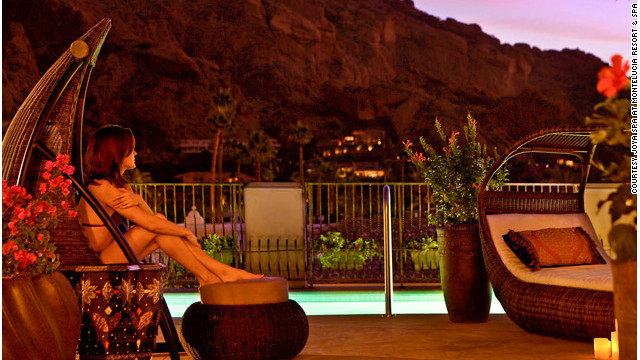 Spa-goers at the Joya Spa at the Montelucia Resort & Spa in Scottsdale, Arizona, have the best views of the dramatically carved and layered Camelback Mountain from the spa's rooftop pool. <a href='http://www.budgettravel.com/slideshow/photos-girls-weekend-world-spas-with-incredible-views,8525/' target='_blank'>See more photos of the spas at BudgetTravel.com</a>.