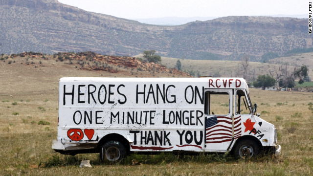 A truck offers a message for firefighters west of Fort Collins on Monday. More than 1,700 personnel are battling the wildfire. 