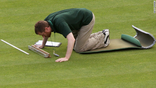 A member of the Wimbledon ground staff monitors one of the test areas on Centre Court.