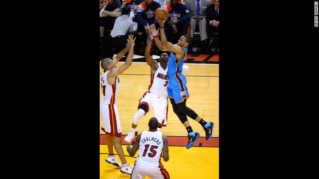 Russell Westbrook, No. 0 of the Thunder, drives for a shot in the first quarter against Dwyane Wade, No. 3; Shane Battier, No. 31; and Mario Chalmers, No. 15, of the Heat. View photos from <a href='http://www.cnn.com/2012/06/17/us/gallery/nba-finals-game-three/index.html'>Game three of the NBA Finals</a>.