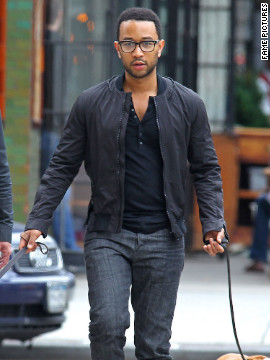 John Legend walks his dogs around New York City.
