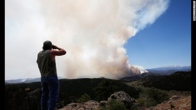 Local resident Dwayne Crawford looks out at the High Park Fire from his home west of Fort Collins on Tuesday, June 19.