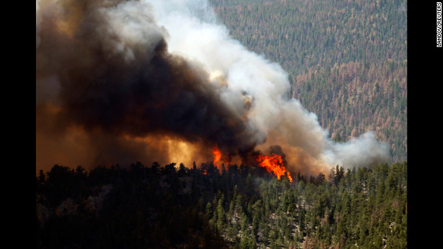 The High Park Fire rages through the forest west of Fort Collins, Colorado, on Tuesday, June 19.