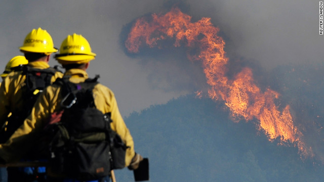 Firefighters watch as the wildfire spreads throught the Los Padres National Forest on June 16. Another fire in San Diego County has burned almost 1000 acres leading to 150 homes being evacuated.