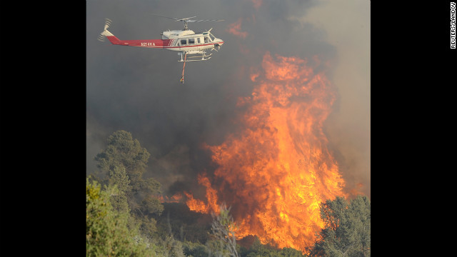 A helicopter makes a water drop on the wildfire in Los Padres National Forest on June 16.