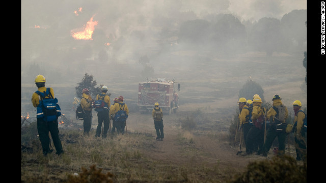 Firefighters battle the Little Bear Fire in the Lincoln National Forest in New Mexico on June 14. The Little Bear Fire had burned more than 40,000 acres and was still spreading.