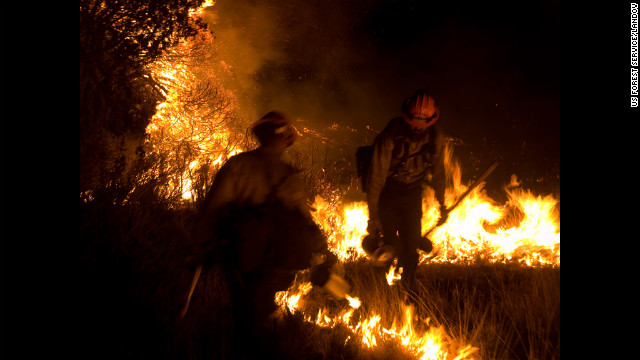 Firefighters in New Mexico struggle on June 14 to contain the Little Bear blaze, which has destroyed more than 250 structures.