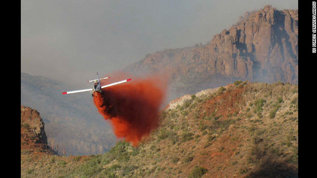 An airplane drops retardant on the 257 Fire near Superior, Arizona, on June 14. The blaze was about 85% contained at a size of more than 2,800 acres. 