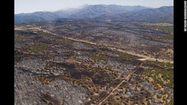 This portion of landscape was charred by the Little Bear Fire in New Mexico on June 14. Are wildfires blazing near you? Share photos and videos with iReport <a href='http://ireport.cnn.com/topics/16940' target='_blank'>here</a>, but please stay safe.&#8221; border=&#8221;0&#8243; height=&#8221;360&#8243; id=&#8221;articleGalleryPhoto0041&#8243; style=&#8221;margin:0 auto;display:none&#8221; width=&#8221;640&#8243;/><cite style=