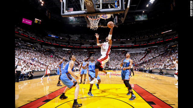 The Heat's Chris Bosh goes to the basket against the Thunder.