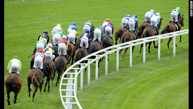 Runners take the bend away from the grandstand at Ascot racecourse.