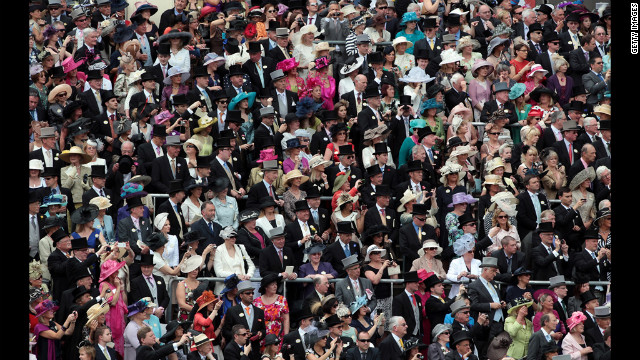 Race-goers from The Royal Enclosure watch the arrival of the royal family.