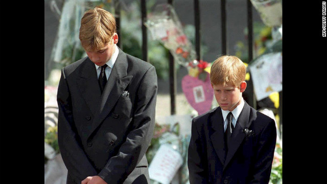 At age 15, Prince William and his brother Harry, 12, bow their heads after their mother's funeral at Westminster Abbey on September 6, 1997. Princess Diana died in a car crash in Paris that August.