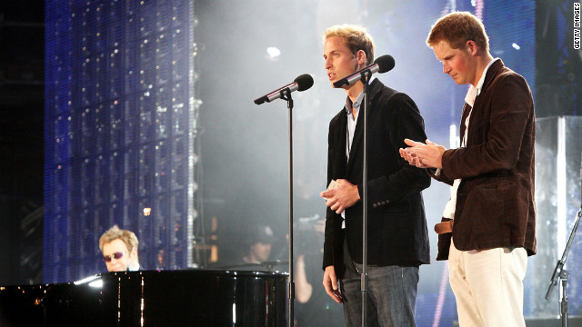 Prince William and Prince Harry speak on stage with Sir Elton John, far left, during a concert they put on to celebrate Princess Diana on July 1, 2007.