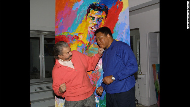 Muhammad Ali and Neiman clown around during Ali's visit to Neiman's New York studio to see his newest serigraph &quot;Muhammad Ali-Athlete of the Century&quot; in 2001.