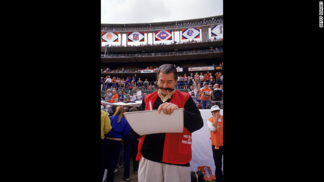 Neiman works on a sketch on the sidelines during Super Bowl XXII between the Washington Redskins and the Denver Broncos in January 31, 1988.