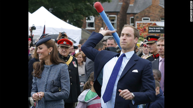 Prince William throws a foam javelin as the Duchess of Cambridge stands at his side during a visit to Nottingham, England, on June 13, 2012. The couple were in the city as part of Queen Elizabeth II's diamond jubilee tour, marking the 60th anniversary of her accession to the throne.