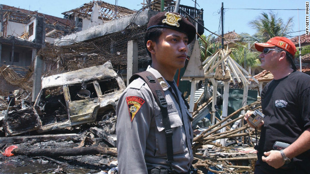 Immediately after the blasts, more than 400 people were reported missing, according to Australian Federal Police. In the following months, the death toll was confirmed at 202, including 88 Australians. A tourist looks at the destroyed building of what remains of Paddy's Bar the day after the attack.