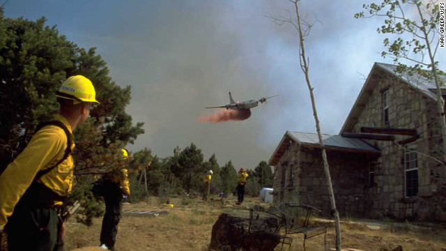 "Greer's second-place image is from the ""wildland/urban interface"" category of firefighters watching a retardant drop on the Burn Canyon Fire in Colorado."