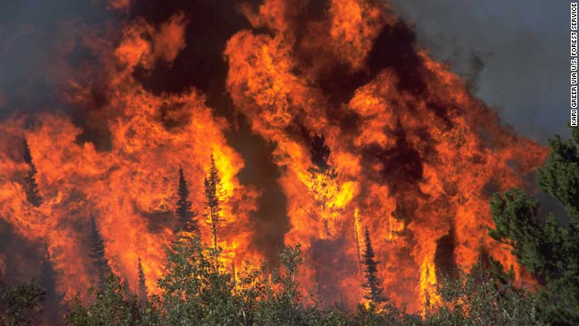 "Greer's second-place image in the ""wildland fire"" category shows extreme fire behavior on the Blackhall Fire in Wyoming."