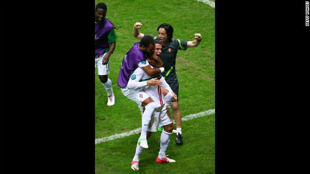 Portugal's Cristiano Ronaldo celebrates scoring the opening goal with his teammates during the quarter final match against the Czech Republic.