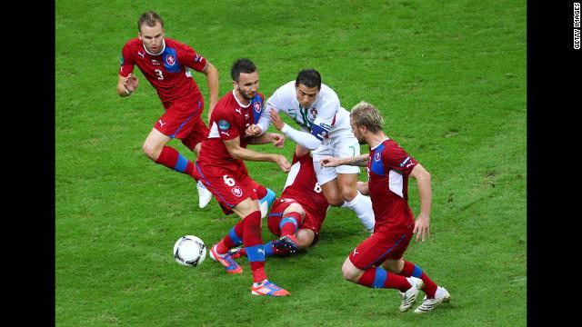 Tomas Sivok and David Limbersky of Czech Republic defend the attack of Portugal's Cristiano Ronaldo.