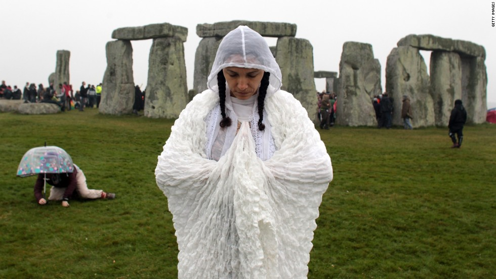 A summer solstice reveler stands in front of Stonehenge, the prehistoric monument near Salisbury, England, where hundreds gather annually on June 21, the longest day of the year in the northern hemisphere.