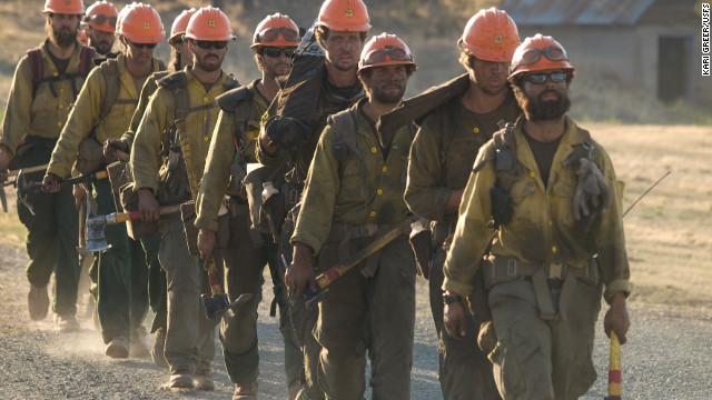 The Idaho City Hotshots firefighting team comes down after several nights battling Little Bear Fire in Lincoln National Forest in New Mexico on June 15.