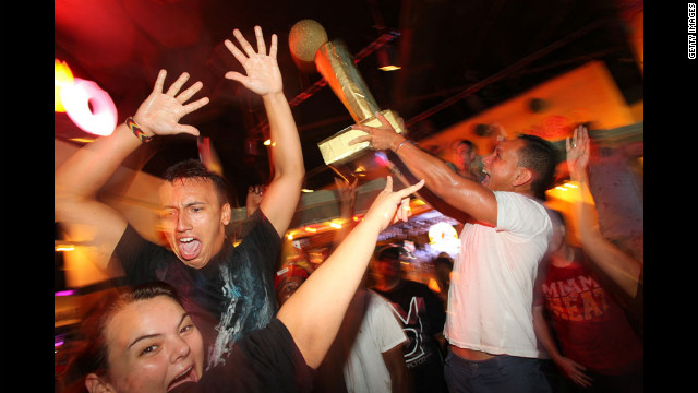 Miami Heat fans celebrate the team's win over the Oklahoma City Thunder in the 2012 NBA Finals on Thursday, June 21 in Miami.