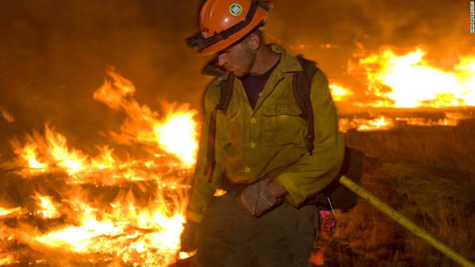 <a href='http://www.kariphotos.com/' target='_blank'>Photographer Kari Greer </a>has spent years documenting wildfires and firefighters in much of the United States. In this photo, a firefighter works a low-intensity burn operation June 14 at Lincoln National Forest in New Mexico.