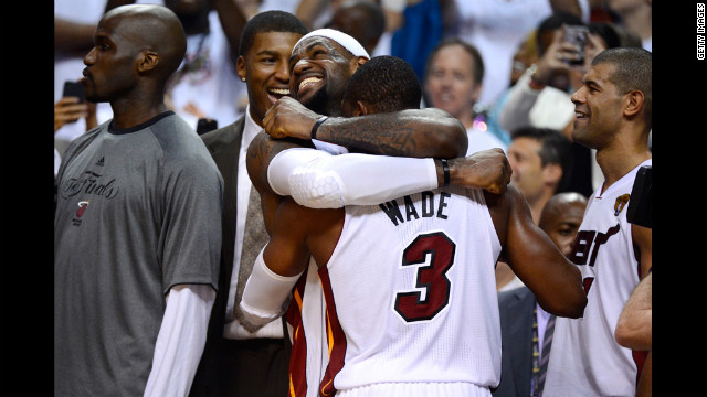LeBron James No. 6 and Dwyane Wade No. 3 of the Heat celebrate late in the fourth quarter against the Thunder.