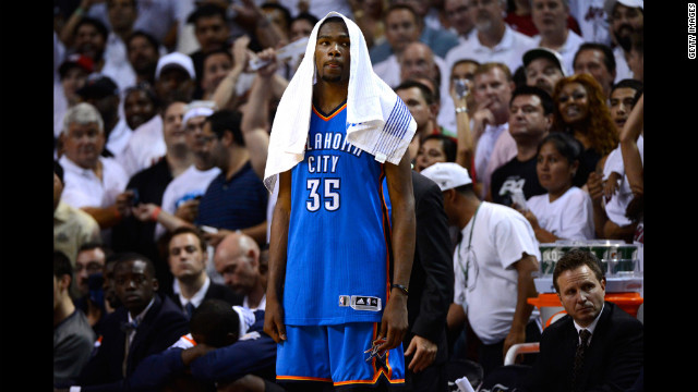 Kevin Durant No. 35 of the Thunder looks on dejected late in the fourth quarter against the Heat.