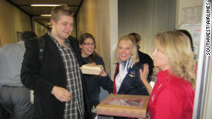 Southwest Airlines flight attendant Holly Hansen being presented with a cookie cake of appreciation.