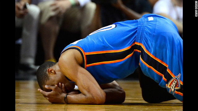 Russell Westbrook No. 0 of the Thunder covers his face as he kneels on the court in the second half against the Heat.