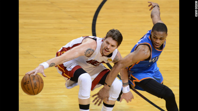 Mike Miller, left, of the Heat is guarded by Russell Westbrook, right, of the Thunder.