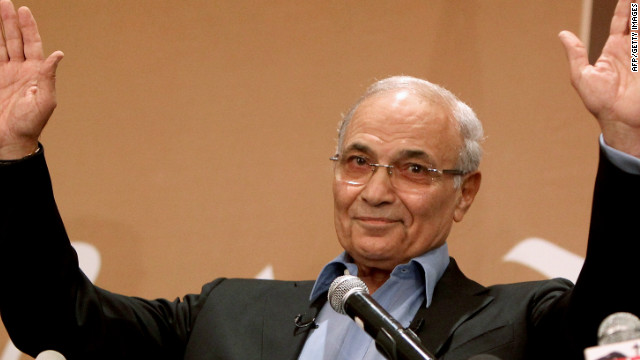 Former Prime Minister Ahmed Shafik is claiming victory as Egyptians await presidential election results.