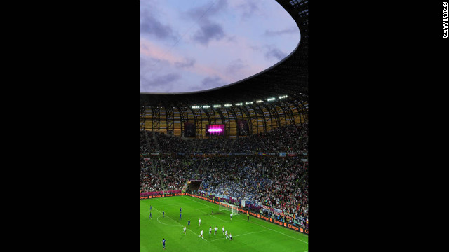 Tens of thousands of fans in the Memorial Stadium watch as the German team celebrates after a goal.<br/><br/>