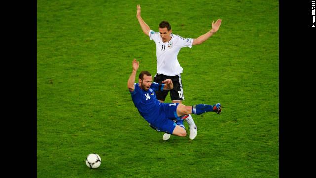 Germany's Miroslav Klose clashes with Greece's Dimitris Salpigidis.