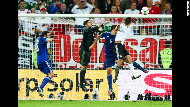 Miroslav Klose of Germany scores their third goal during the quarterfinal match between Germany and Greece.