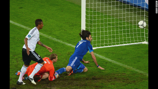 Georgios Samaras of Greece scores the team's first goal past Manuel Neuer of Germany.