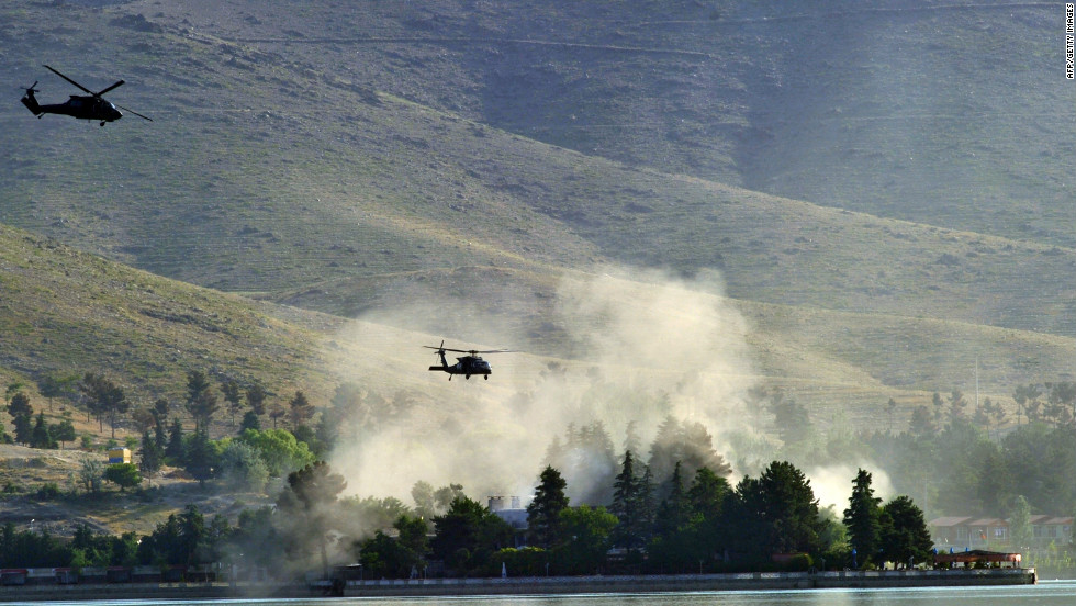 NATO Black Hawk helicopters fly near the Spozhmai Hotel near Kabul on Friday, June 22. Taliban militants attacked the hotel Friday and seized dozens of hostages, sparking a fierce gunbattle with Afghan and NATO troops that left 26 people dead, authorities said.