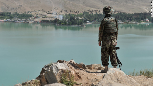 An Afghan soldier looks across Qargha Lake at the hotel. 