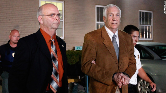Sandusky faces the cameras as he is led to a sheriff's vehicle in handcuffs after the reading of the verdict.