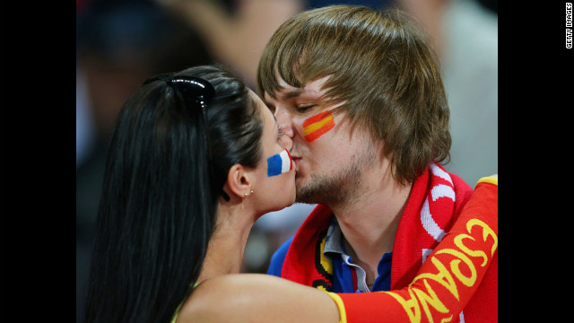 At least two fans of Spain and France were able to put aside their differences for Saturday's Euro 2012 quarterfinal game.