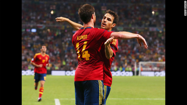 Xabi Alonso of Spain celebrates after scoring the first goal with Cesc Fabregas during Spain's quarterfinal match against France.