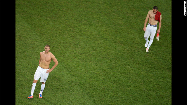 Karim Benzema and Franck Ribery of France look dejected after defeat during the quarter final match between Spain and France.