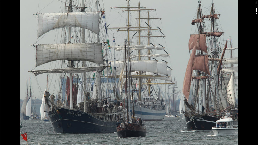 Tall ships participate in the Windjammer Parade on Saturday, June 23, 2012, in Kiel, Germany. 