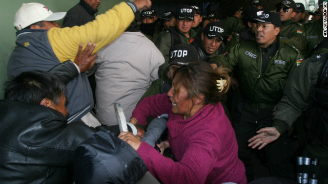 Striking Bolivian police officers struggle with members of the anti-riot brigade (UTOP) at the riot unit's headquarters in downtown La Paz on June 21, 2012.