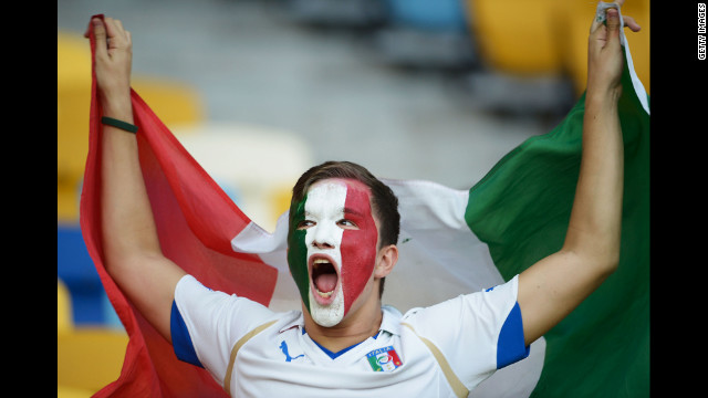 An Italy fan enjoys the atmosphere ahead of Sunday's quarterfinal match.